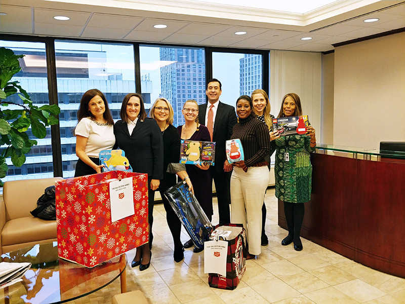 Cuddy and Feder employees posing with salvation army and toys collected
